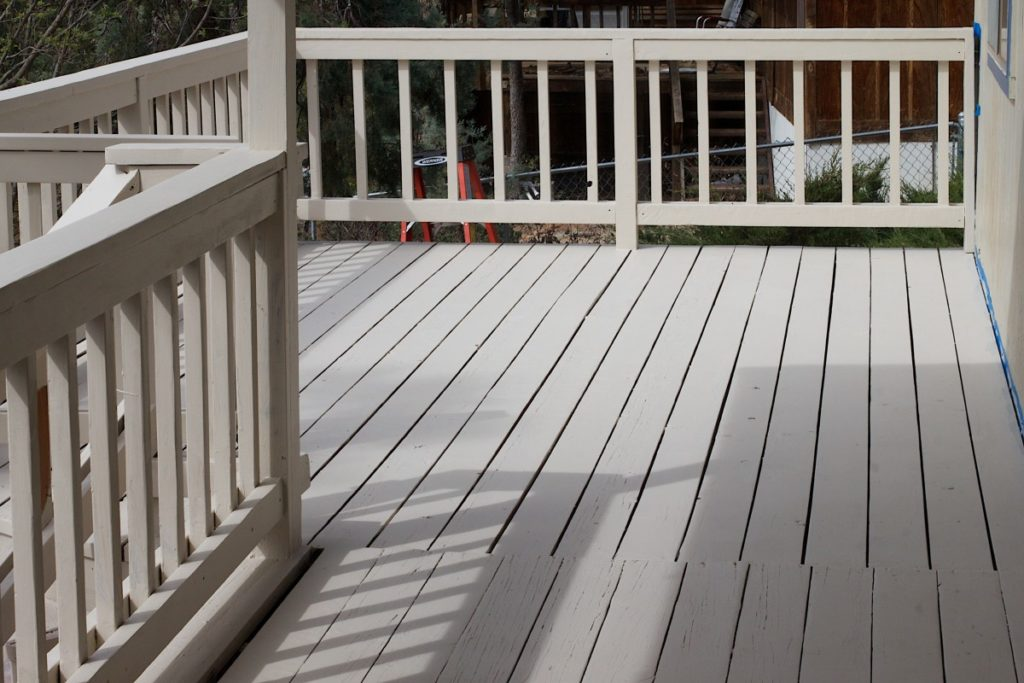 deck with wooden railings