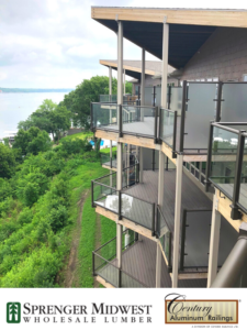 """Commercial Project  Style Used: Glass Railings, 3"""" Custom 45-Degree Posts and Custom Tinted Glass Color: Textured Black Location: Bridges Bay Resort in Arnolds Park, IA. Located on one of the last large strips of available beachfront on the shore of East Lake Okoboji, Bridges Bay Resort saw the need for expansion in 2016. This year-round resort features individually-owned condominiums and hotel-style guest rooms for short-term or long-term rental with beautiful outdoor patios and decks finished with Century Aluminum Railings.   """"The views from the decks and patios are incredible,"""" says Todd Kappenman, Senior Regional Accounts Manager at Sprenger Midwest. """"The glass railings by Century Aluminum Railings were a perfect choice to use for unobstructed deck views all while meeting safety requirements.""""    In addition to the glass railings, textured black, 3"""" custom 45-degree posts and custom tinted glass were installed. Contributor: Sprenger Midwest"""